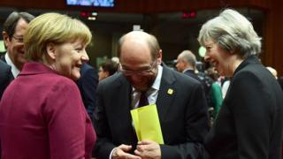 Theresa May with Angela Merkel and Martin Schulz, speaker of the European Parliament