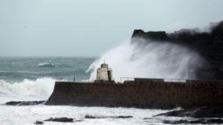 Waves crashing against cliffs in Portreath during Storm Eleanor