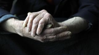 Dementia sufferer rubs hands together