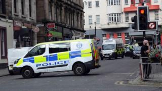 Police van and ambulance in Elmbank Street, Glasgow