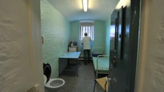 A prisoner in a cell at Wormwood Scrubs