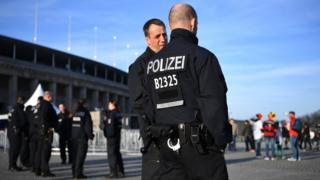 Policemen patrol outside the ground prior to the International Friendly match between Germany and England