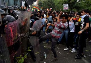 Demonstrators clash with riot police during a protest