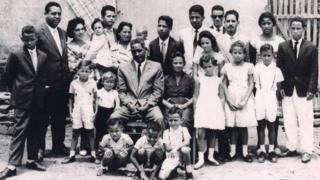 Vania Nascimento's family gather for a photograph
