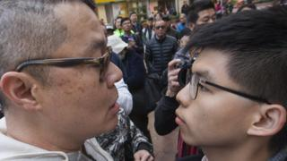 "An unknown heckler (L) faces off with pro-democracy activist Joshua Wong (R) at an election rally for Hong Kong Legislative Council by-election pro-democracy candidate Au Ngok-hin in Aberdeen Square in the Hong Kong Island geographical constituency, Hong Kong, China, 11 March 2018. Hong Kongers go to the polls 11 March 2018 to vote for four new lawmakers after the disqualification of four lawmakers for what Hong Kong""s High Court ruled was improper oath-taking in a swearing-in ceremony after the 04 September 2016 Legislative Council elections. EPA/ALEX HOFFORD"