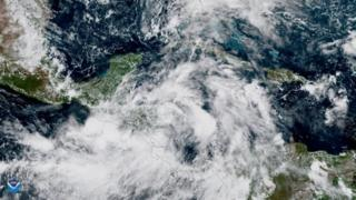 Tropical Storm Nate gains strength in the Caribbean Sea as it moves toward the U.S. Gulf Coast in this NOAA Satellite image taken October 6, 2017.