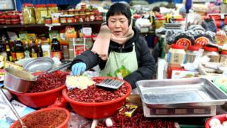 A woman at a market in China