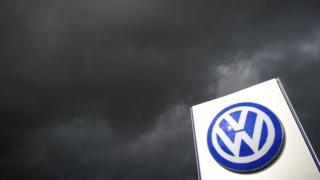 Volkswagen sign with storm clouds behind