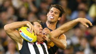 APRIL 01: Travis Cloke of the Magpies is tackled by Alex Rance of the Tigers during the round two AFL match between the Collingwood Magpies and the Richmond Tigers at Melbourne