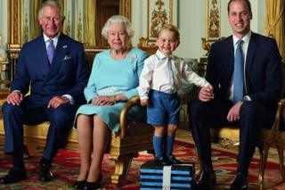 Prince George stands on foam blocks during the photo shoot for the stamp sheet
