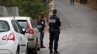 French police officers stand at the scene where Jacqueline Veyrac was found alive two days after being kidnapped