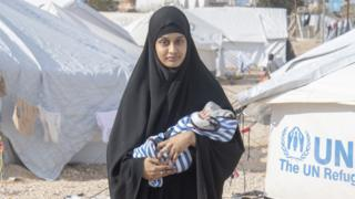 PERMISSION ONLY TO USE FOR 24 HOURS AFTER 22:00 ON 8/03/19. Shamima Begum with her week old son Jerrah