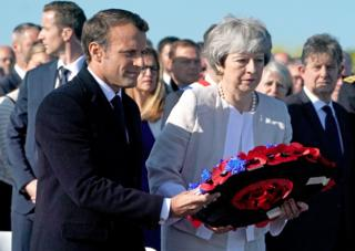 Mrs May and Mr Macron lay a wreath together