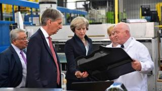 Philip Hammond and Theresa May during a visit to a manufacturing centre at the University of Warwick last month