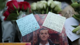 Floral tributes for victims of the terrorist attack, including Jack Merritt, left on London Bridge in central London