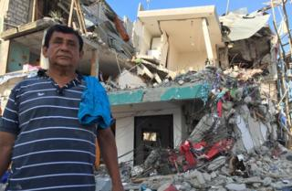 Nexar Santana Lopez outside his damaged home in Pedernales, Ecuador - 19 April 2016