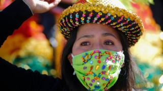 Woman with mask protesting in Bolivia