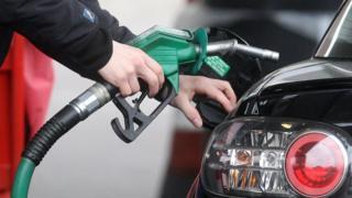 Filling car at filling station
