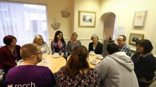 Theresa May meets volunteers from the Wellbeing Centre in Aldershot, Hampshire