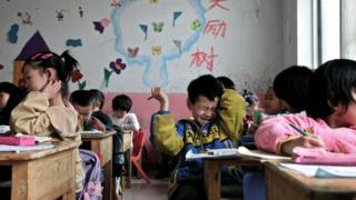 Young Chinese children attend a kindergarten