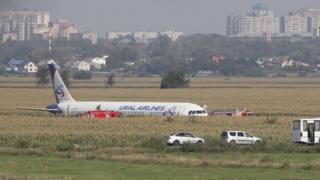 A Ural Airlines A-321 passenger plane is seen oon the site of its emergency landing in a field outside Zhukovsky airport in Ramensky district of Moscow region, Russia.