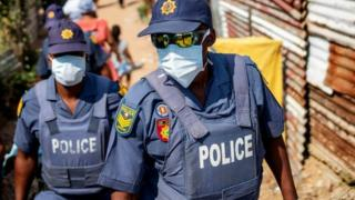 Two police officers wearing masks
