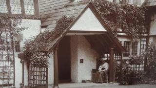 Photo believed to be of Beatrix Potter sat in the porch of Broad Leys
