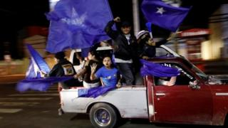 Supporters of President and National Party presidential candidate Juan Orlando Hernandez take part in a vehicle caravan rally as they wait for official presidential election results in Tegucigalpa, Honduras, November 27, 2017.