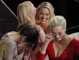 Sally Hawkins, Saoirse Ronan, Margot Robbie and Meryl Streep hugging each other