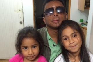 Man with two daughters