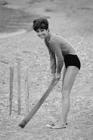 Audrey Hepburn playing cricket