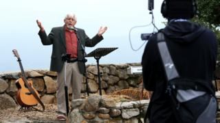 Pastor George Runyan gives a sermon during a sunrise Easter service at Mt Helix Park in San Diego, California, 12 April 2020