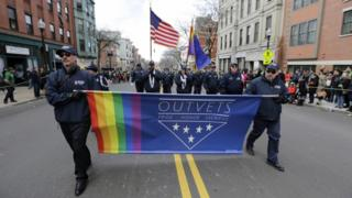 OutVets marching with rainbow flag