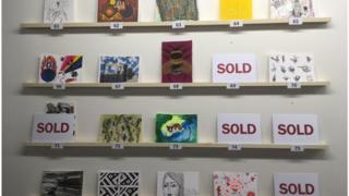 Postcards on shelves