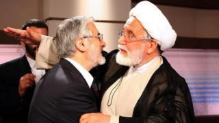 Mousavi and Karroubi embrace