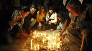 Lebanese leftists light candles in front of the electricity authority in Beirut on November 23, 2009 during a protest against power cuts
