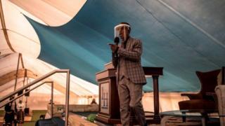 Prophet Paseka Motsoeneng, popularly known as Prophet Mboro, wears a face mask as he celebrates inside the Incredible Happenings Ministry Church, in Katlehong, Ekurhuleni on June 07, 2020.