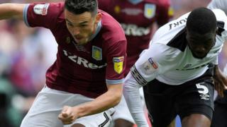 "Villa's John McGinn in action with Derby County""s Fikayo Tomori"