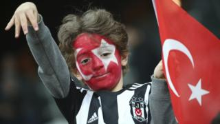 A Besiktas fan, his face painted with the colours of the Turkish flag, at the soccer match between Beisktas and Kayserispor, the first game since Saturday's twin attacks outside the stadium in Istanbul, 14 Wednesday 2016