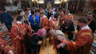 Russian Orthodox believers line up to kiss the relics of Saint Nicholas in the Christ the Saviour Cathedral in Moscow