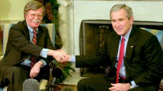 US President George W. Bush (R) and Ambassador to the UN John Bolton (L) meet in the Oval Office of the White House December 4, 2006 in Washington, DC.