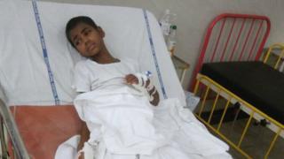 Ravita Walvi lying on a bed in the hospital