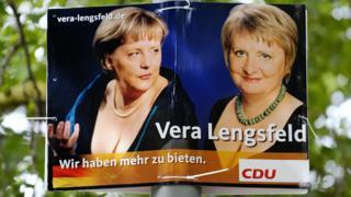 Плакат Меркель и Ленгсфельд