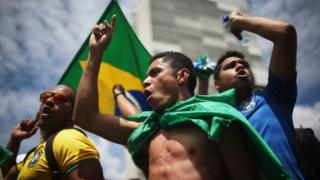 Anti-government demonstrators chant with Brazilian flags outside the National Congress building