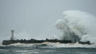 Surging waves generated by Typhoon Hagibis hit against a breakwater at a port in the town of Kiho, Mie Prefecture, Japan, 12 October 2019