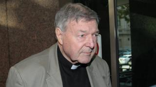 Cardinal George Pell arrives for the court hearing in Melbourne