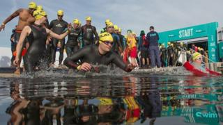 Swimmers at the starting point