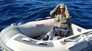 Kushila Stein in her rubber dinghy after being rescued by the Hellenic Coast Guard