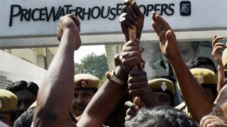 Members of the Communist Party of India (CPI) protest outside the office of PricewaterhouseCoopers, the auditing firm for the scandal-hit Satyam Computers, in Hyderabad on January 20, 2009 calling for the closure of the audit firm in addition to the cancellation of license.