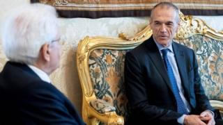 Carlo Cottarelli (left) meets Italian President Sergio Mattarella